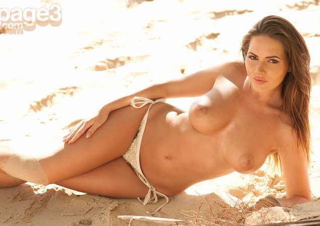 Sabine Jemeljanova cools off topless under the palm tree for Page 3
